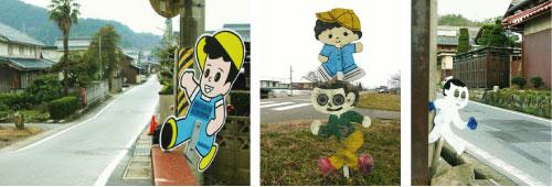 「飛び出し坊や」、「飛び出しくん」などの愛称をもつ「飛び出し人形」。地域ごとにオリジナルの「坊や」が飛び出しています。プレス機で量産されている「飛び出し坊や」(写真左)もあります